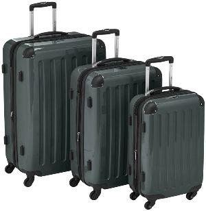 На фото темно-серые чемоданы разного размера.